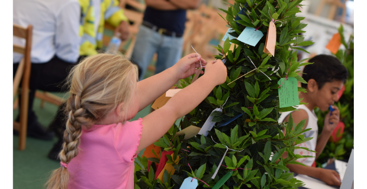 picture of girl adding to the pledge tree