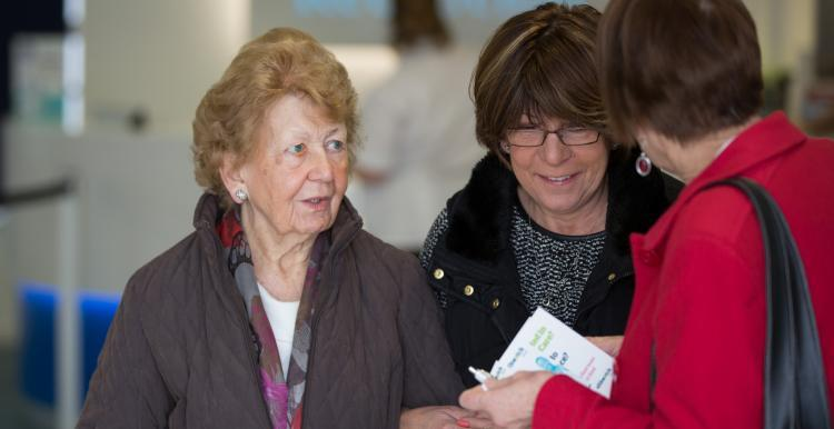women talking to healthwatch representative